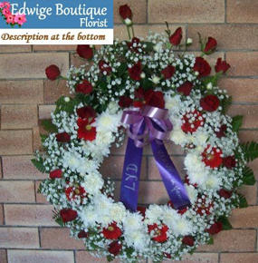 Round Funeral Wreath with red roses and gerberas and white gypsophila and crysenthem