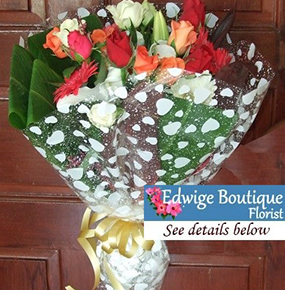Gerberas, lilies and colourful roses